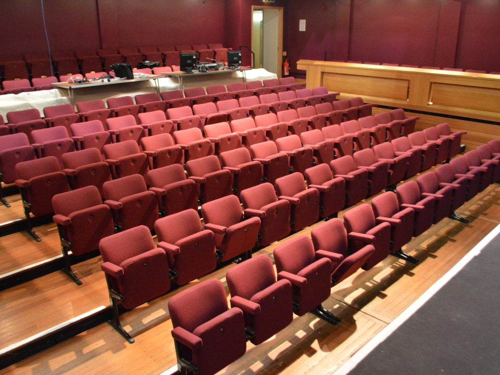 Theatre seat upholstery auditorium upholstery recover Hampton Hill theatre - Hill Upholstery & Design